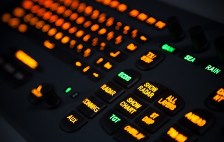 Fragment of illuminated industrial keyboard in the dark  Selective focus photo
