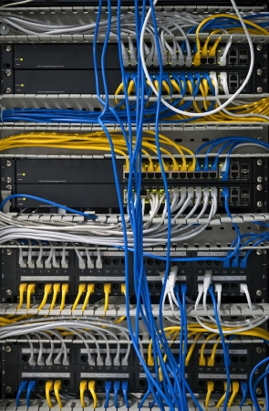 Large network hubs with connected cables photo