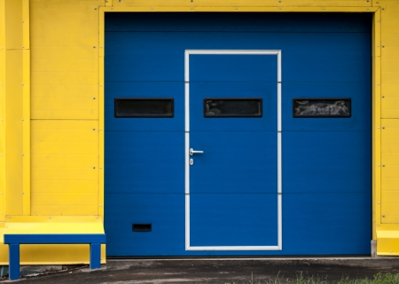 Texture of modern yellow garage wall with closed blue gate Stock Photo - 16004141