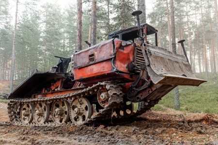 Experienced rusty all-terrain vehicle on tracks photo