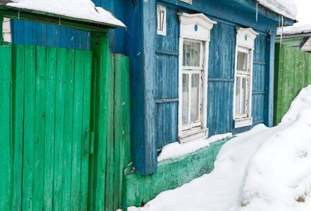 Winter street with wooden old rural houses and snow drifts  Historical town Kolomna, Moscow region, Russia photo