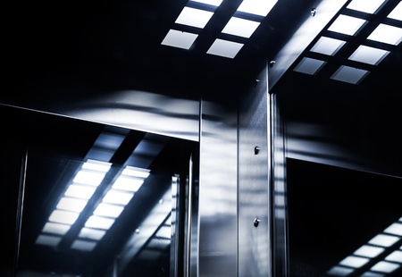 Abstract modern dark inter fragment with shining steel and mirrored glass Stock Photo - 16307679