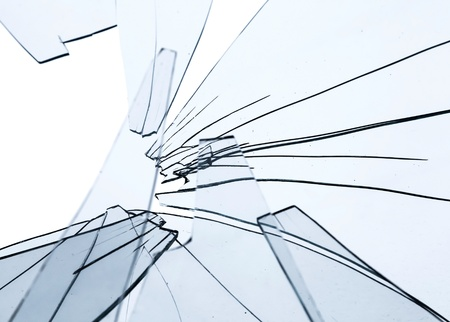pane: Broken glass fragments above white. Abstract background texture Stock Photo