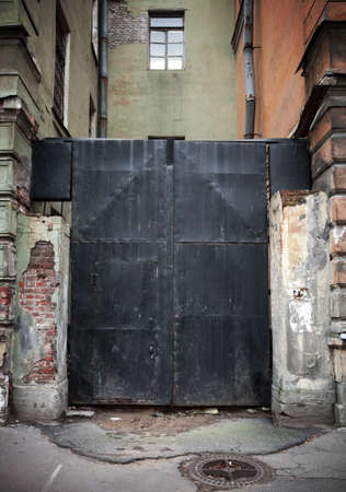 Old locked black metal square gate in old part of St Petersburg, Russia photo