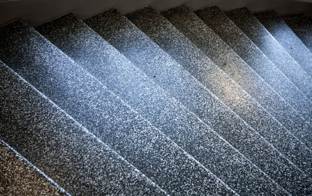 Dark stone shining stairs goes down  Abstract architecture fragment photo