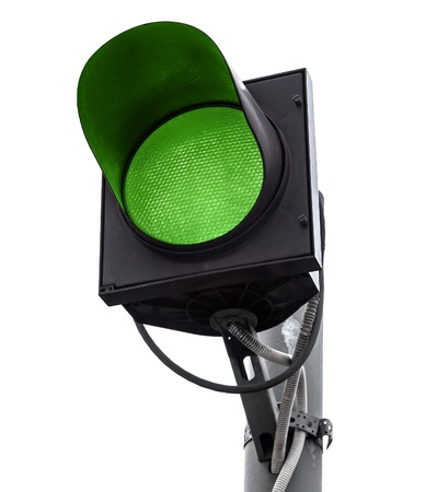 light traces: Green traffic light isolated on white