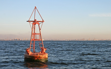 Floating old red buoy on Baltic Sea photo