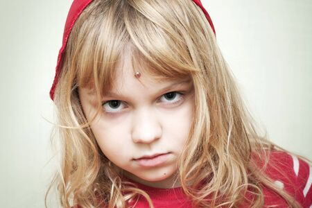 sullenly: Portrait of little blond girl in red Clothing Stock Photo