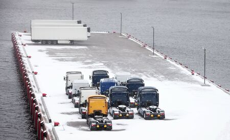 Trucks and trailers waits on snowbound pier in port Stock Photo - 16875372