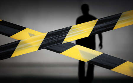 Black and yellow striped tapes and violator man silhouette behind it Stock Photo - 16875296