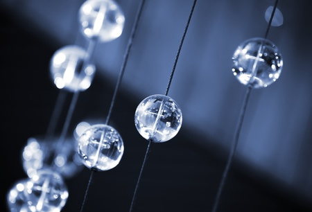 Abstract dark blue background with glass spherical design elements of modern chandelier Stock Photo - 16910209