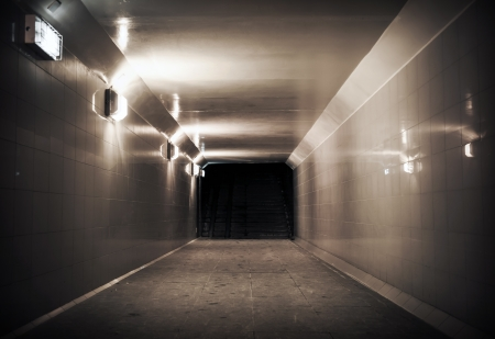 Underground passage with lights and stairs in dark end Stock Photo - 16943112