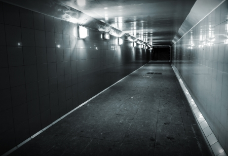 Monochrome photo of underground passage with lights and stairs in dark end Stock Photo - 16943113