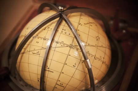 Vintage travel star sky globe in wooden box photo