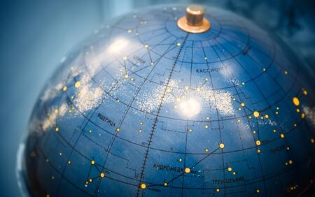 Old star sky globe with Russian text photo
