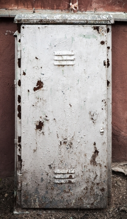 Old metal door texture with gray cracked painting photo
