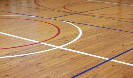 ground floor: Wooden floor of sports hall with marking lines Stock Photo