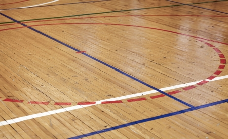 Wooden floor of sports hall with colorful marking lines Stock Photo