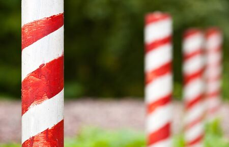 Red and white striped poles in the row Stock Photo - 17045206