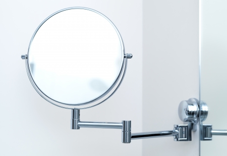 wall mirror: Round wall mirror for the bath. Close-up photo
