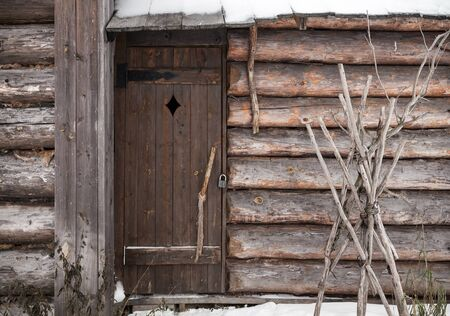 Old wooden building facade with locked door photo