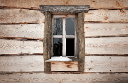 Old wooden building facade texture with small window photo