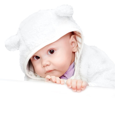 little baby in white bear costume isolated on white background photo