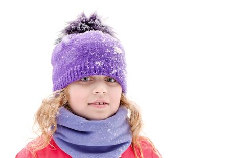 outwear: Little beautiful blond girl in winter outwear with snowflakes above white background Stock Photo