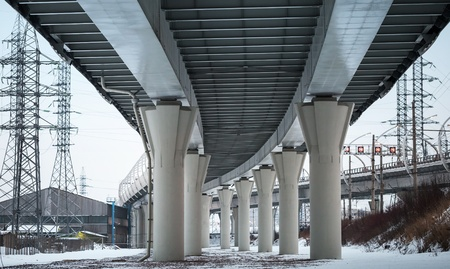 Urban scene with bottom view of steel automotive bridge photo