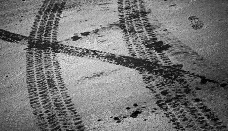 tire marks: Tire tracks and footstep on the asphalt urban road