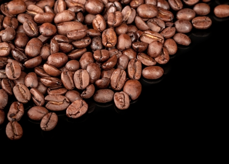 caffee: Roasted coffee beans diagonal on black background