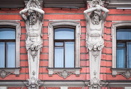 atlantes: Facade with men statues of an old palace in St Petersburg, Russia  Belosselsky-Belozersky Palace is Neo-Baroque style was built in 1847-48 by project of Andrei Ivanovich Stakenschneider
