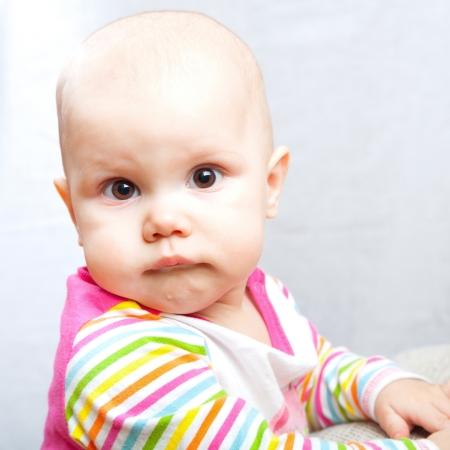 brown  eyed: Little brown eyed baby pursed her lips  Сloseup studio portrait Stock Photo