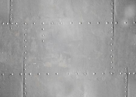 Abstract detailed gray metal wall background texture with seams and rivets photo