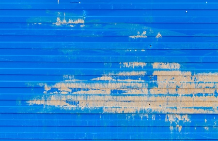 Horizontal ridged blue painted old metal wall background texture photo
