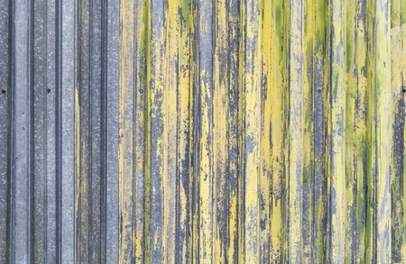 ridged: Ridged yellow painted old metal wall background texture