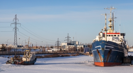 Ships moored in icy harbor  Cargo port of St Petersburg, Russia