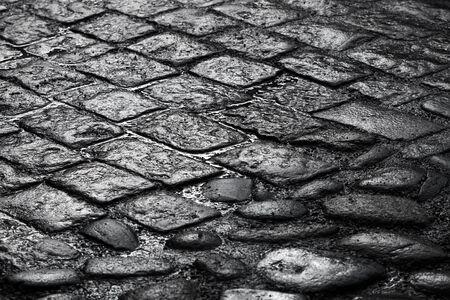 wet floor: Closeup background texture of old wet cobblestone road Stock Photo