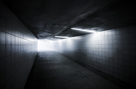 underground passage: Underground passage with lights and glowing end Stock Photo