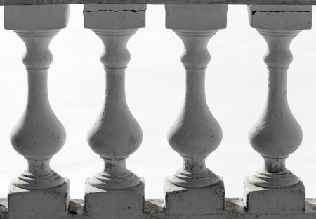 Classical balusters fragment above white background photo