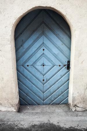 Ancient blue wooden door in old building facade with arch  Tallinn, Estonia Stock Photo - 18855006