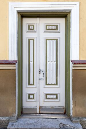 Ancient gray wooden door in old building facade  Tallinn, Estonia photo