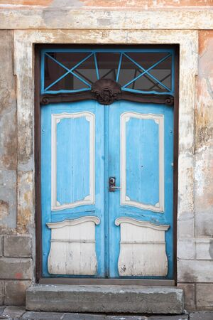 Blue wooden door of old building in Tallinn, Estonia photo
