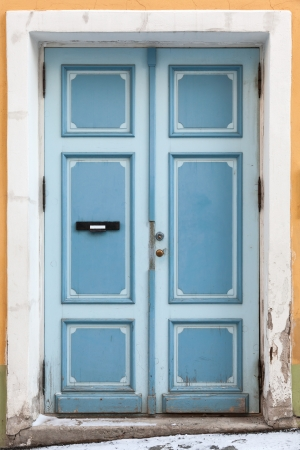 Blue wooden door in old building facade. Tallinn, Estonia photo