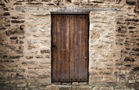 Ancient wooden door in stone castle wall  Tallinn, Estonia