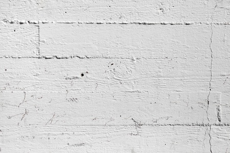Closeup white painted concrete wall texture with wood relief pattern photo