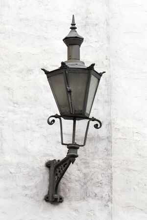 Old Lantern on a white wall in Tallinn, Estonia photo