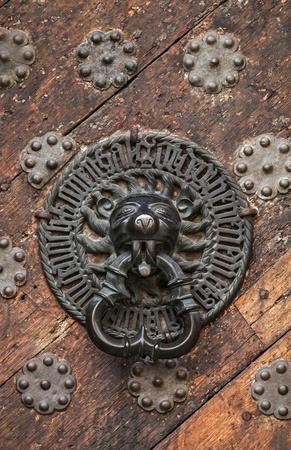 Ancient weathered door fragment with metal lion head handle  Old part of Tallinn, Estonia Stock Photo - 19046807