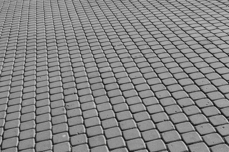 Background texture of modern gray cobblestone pavement surface photo