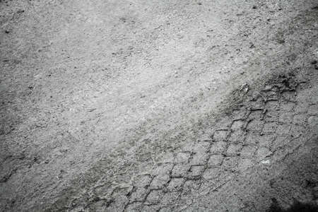 Abstract traffic background  Close-up view of tires tracks on the road dirt photo